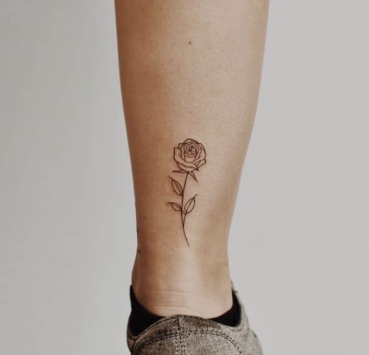 Flower at the back of the leg minimalist tattoo idea