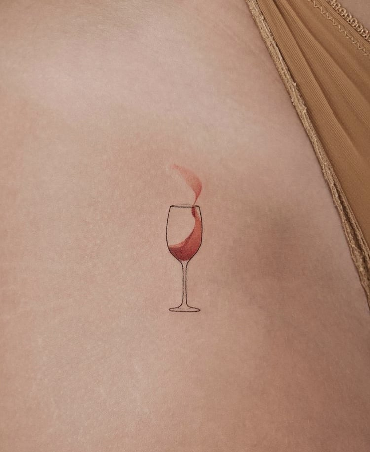 Small wine glass minimalist tattoo idea