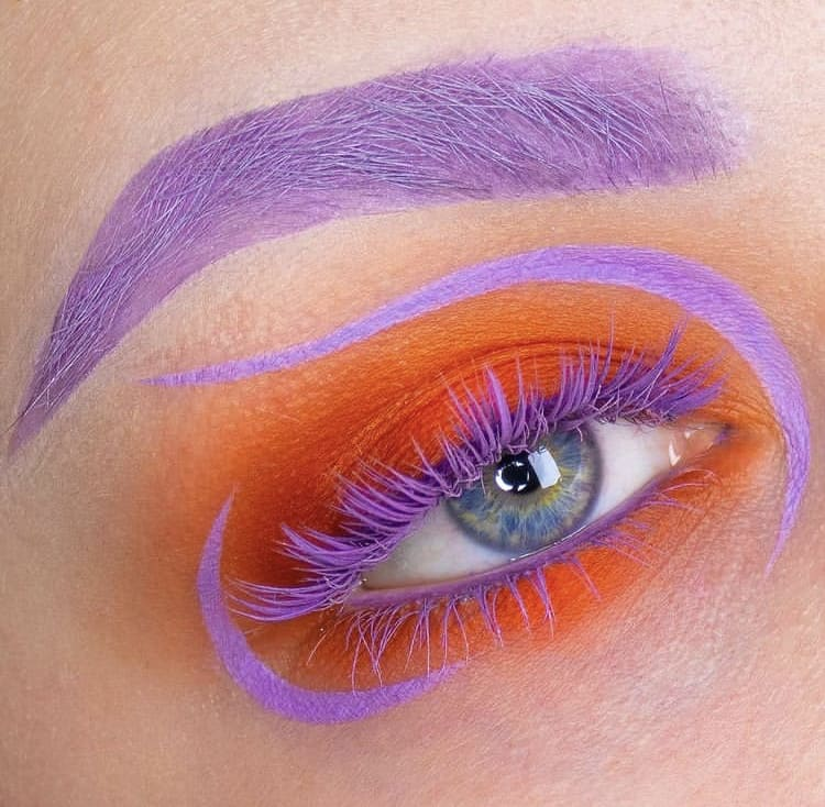 Purple colored eyebrows and eyelashes