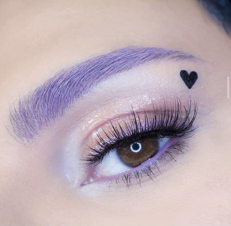 Purple eyebrows and eyeliner