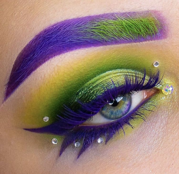 Purple and green eyebrows and eyelashes