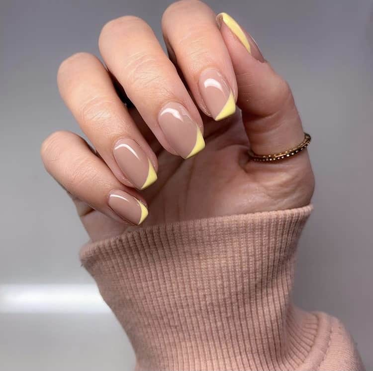 yellow French tips nails