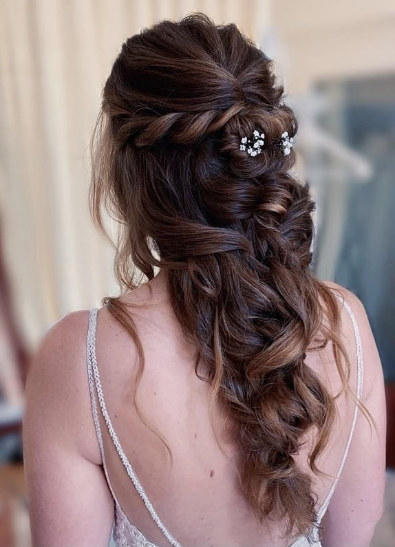 half up messy bridal hairstyle with braids
